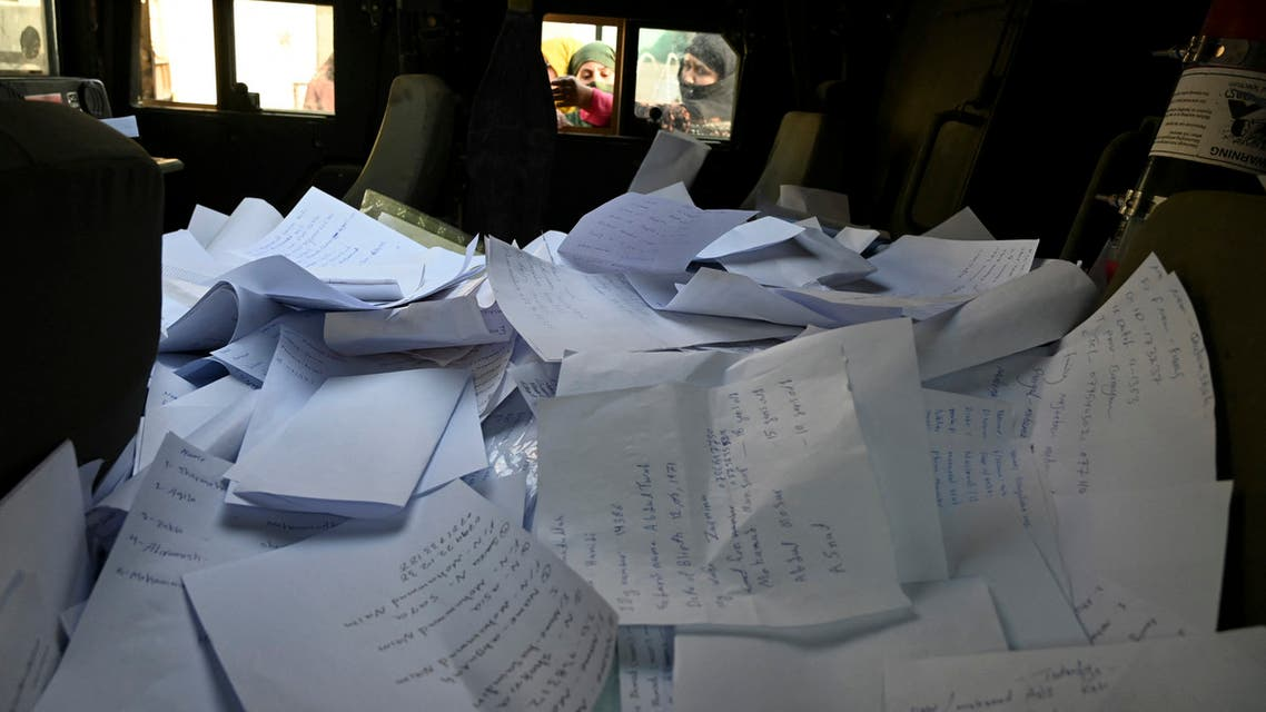 Stack of sheets filled with details of Afghan residents wishing to leave the country is pictured inside a Humvee in front of the British and Canadian embassy in Kabul on August 19, 2021 after Taliban's military takeover of Afghanistan.