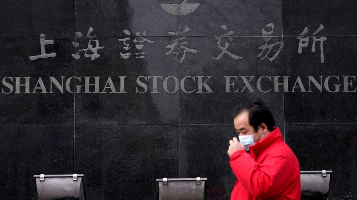 A man walks past the Shanghai Stock Exchange building at the Pudong financial district in Shanghai, China. (Reuters)