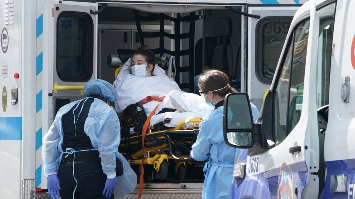 In this file photo taken on April 5, 2020 A woman arrives by ambulance to Wyckoff Hospital in the Bushwick section of Brooklyn April 5, 2020 in New York. (AFP)