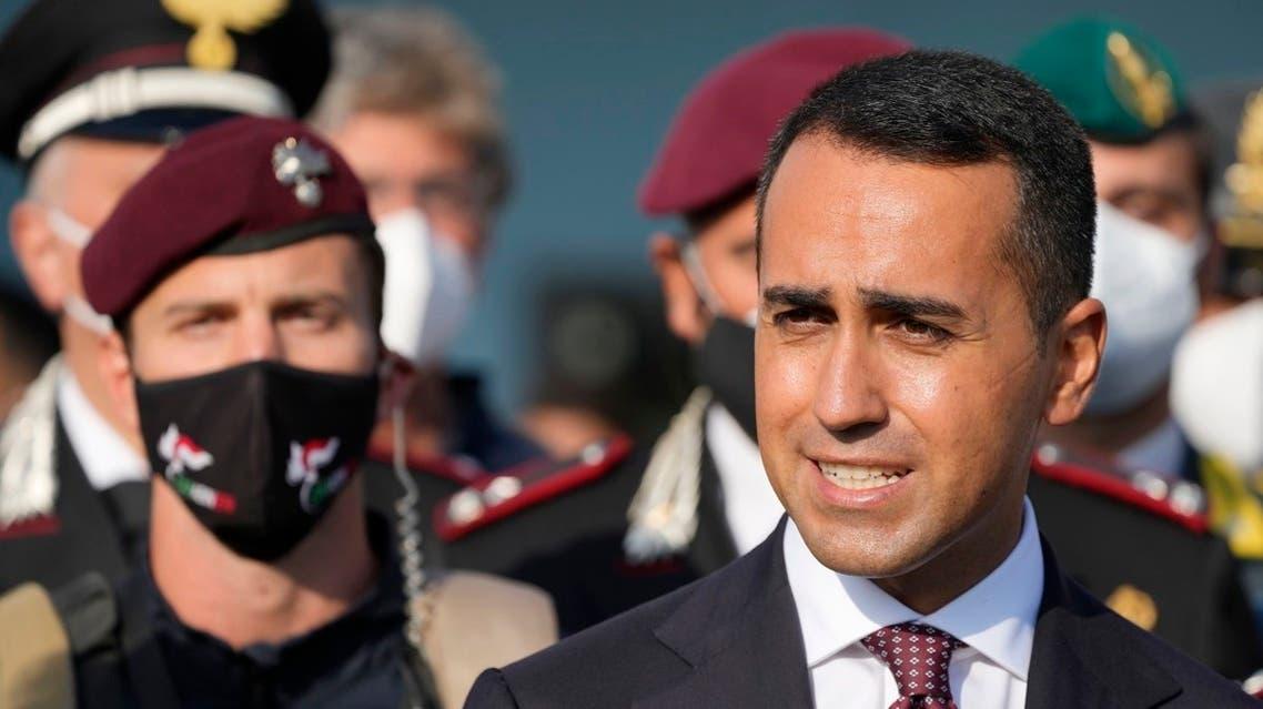 Italian Foreign Minister Luigi Di Maio welcomes Italy's final evacuation flight of refugees from Afghanistan, landed at Rome's Leonardo da Vinci airport Saturday, Aug. 28, 2021. (AP/Gregorio Borgia)