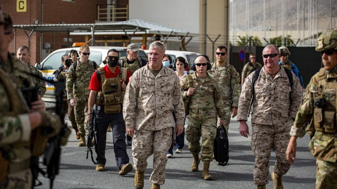 This US Marine Corps photo released on August 18, 2021 shows Commanding General US Central Command Kenneth F. McKenzie touring an evacuation control center at Hamid Karzai International Airport, Afghanistan, on August 17,2021. (AFP)