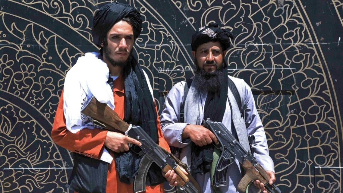 Taliban fighters stand guard in front of the provincial governor's office in Herat on August 14, 2021. (AFP)