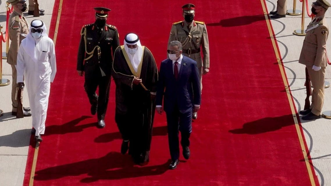 Iraqi Prime Minister Mustafa al-Kadhimi welcomes Kuwaiti Prime Minister Sheikh Sabah al-Khalid al-Sabah, upon his arrival at Baghdad International Airport, in Baghdad, Iraq, August 28, 2021. (Reuters)