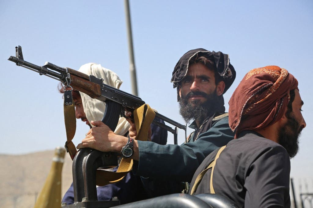 Taliban fighters stand guard in a vehicle along the roadside in Kabul on August 16, 2021. (File photo: AFP)
