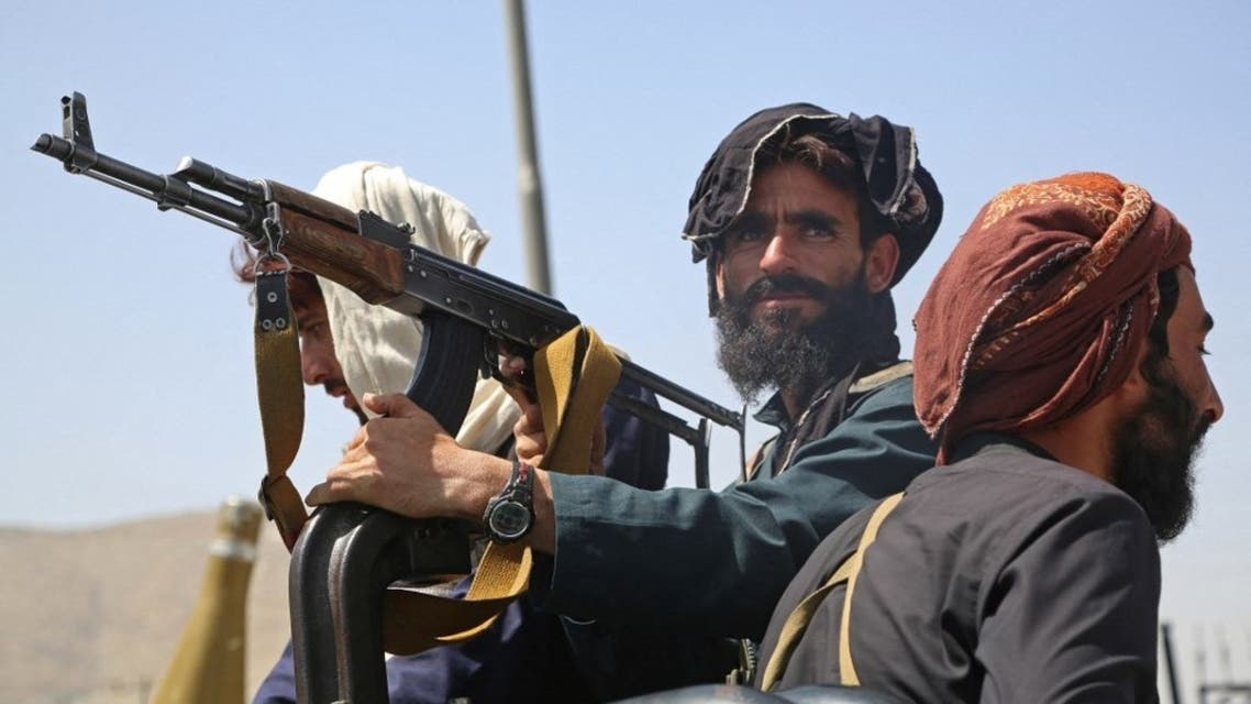 Taliban fighters stand guard in a vehicle along the roadside in Kabul on August 16, 2021. (AFP)