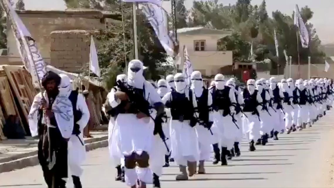 Taliban fighters march in uniforms on the street in Qalat, Zabul Province, Afghanistan, in this still image taken from social media video uploaded August 19, 2021. (Reuters)
