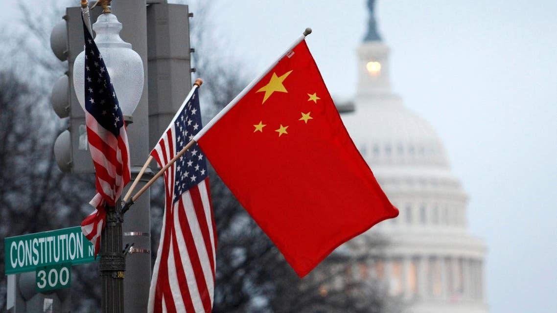 China flag and the U.S. flag fly on a lamp post along Pennsylvania Avenue near the U.S. Capitol in Washington. (File photo: Reuters)