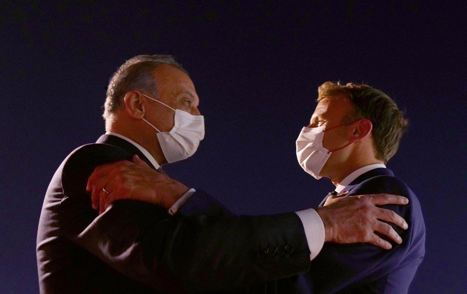 الرئيس الفرنسي ماكرون ورئيس الوزراء العراقس الكاظمي