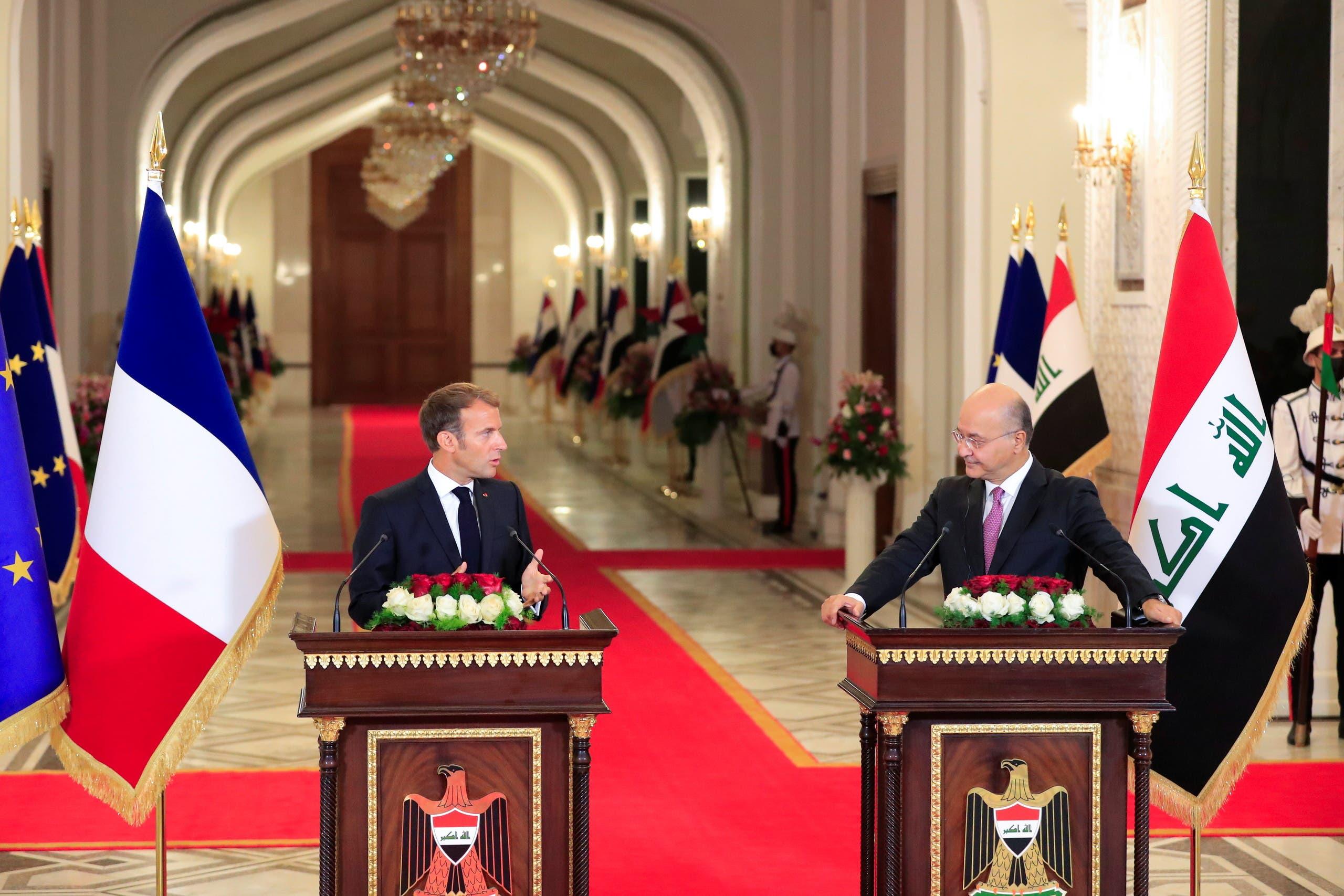 الرئيسان العراقي برهم صالح والفرنسي إيمانويل ماكرون