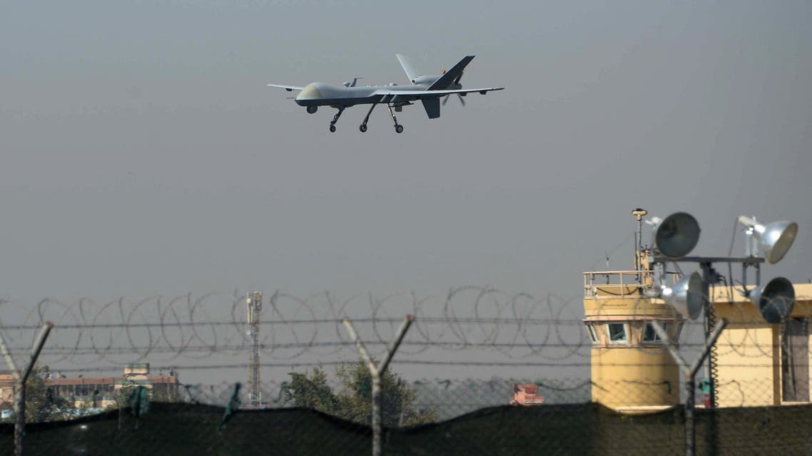 A US drone aircraft lands at Afghanistan's Jalalabad Airport where a US C-130 military transport plane crashed in Jalalabad on October 2, 2015. The Taliban claimed October 1 to have shot down a US military transport plane in eastern Afghanistan in a crash that killed 11 people, as the battle for Kunduz raged after the emboldened militants briefly seized the city.The Taliban's stunning success in Kunduz, their biggest tactical success since 2001, marks a blow for Afghanistan's NATO-trained forces, who have largely been fighting on their own since December 2014. NATO has not yet confirmed the cause of Friday's crash. The Taliban regularly claim to have shot down military aircraft.Our mujahideen have shot down a four-engine US aircraft in Jalalabad, Taliban spokesman Zabihullah Mujahid said on Twitter.Based on credible information 15 invading forces and a number of puppet troops were killed. AFP PHOTO / Noorullah Shirzada