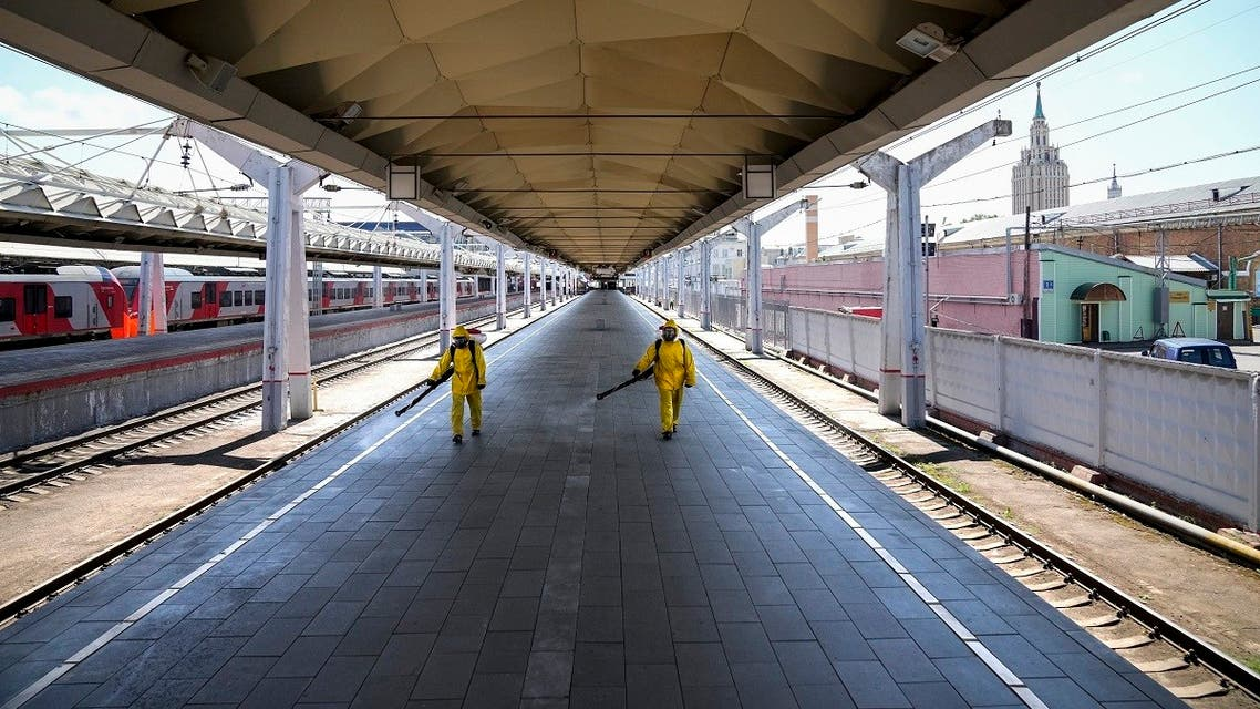 Employees of the Russian Emergency Situations disinfect a platform of Liningradsky railway station in Moscow in Moscow, Russia, July 22, 2021. (AP/Alexander Zemlianichenko)