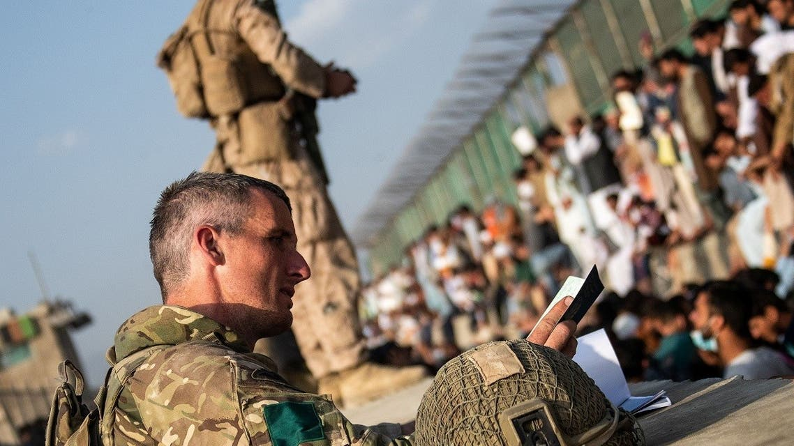 Members of the UK Armed Forces continue to take part in the evacuation of entitled personnel from Kabul airport, in Kabul, Afghanistan August 19-22, 2021, in this handout picture obtained by Reuters on August 23, 2021. (LPhot Ben Shread/UK MOD Crown copyright 2021/Handout via Reuters)