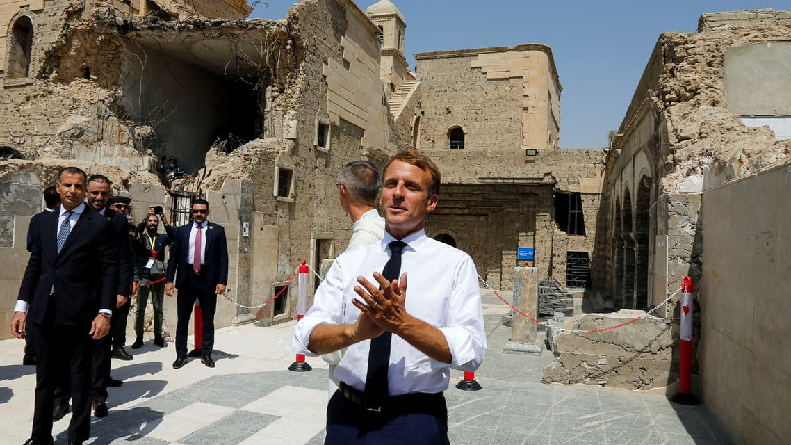 French President Emmanuel Macron visits al-Sa'ah church in the Old City of Mosul, Iraq, August 29, 2021. (Reuters)