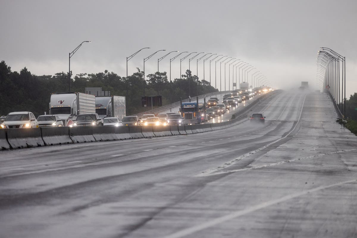 Traffic moves bumper to bumper along I-10 west as residents arrive into Texas from the Louisiana border ahead of Hurricane Ida in Orange, Texas, US, August 28, 2021. (Reuters)