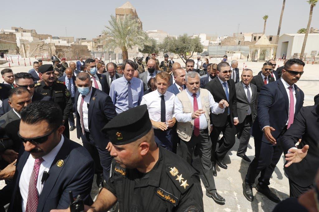 ماكرون خلال زيارته إلى الموصل (أ ف ب)