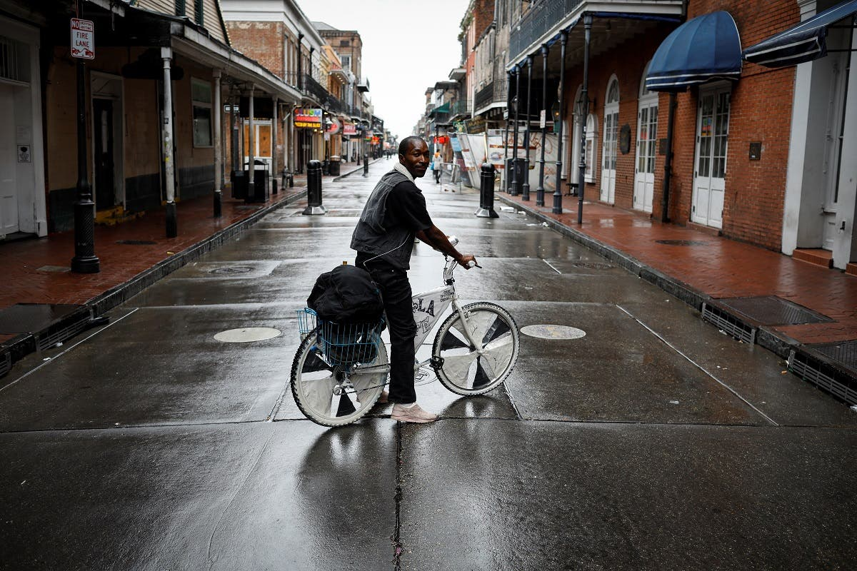 A man rides a bicycle in Bourbon Street at the French Quarter ahead of Hurricane Ida, in New Orleans, Louisiana, U.S. August 29, 2021. (Reuters)