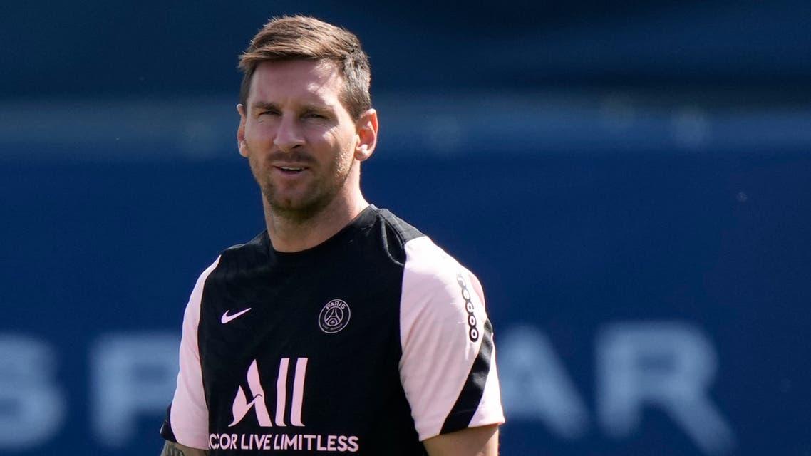 Lionel Messi walks on the pitch at the Paris Saint-Germain training camp in Saint-Germain-en-Laye, west of Paris, Friday, Aug. 13, 2021. (AP)