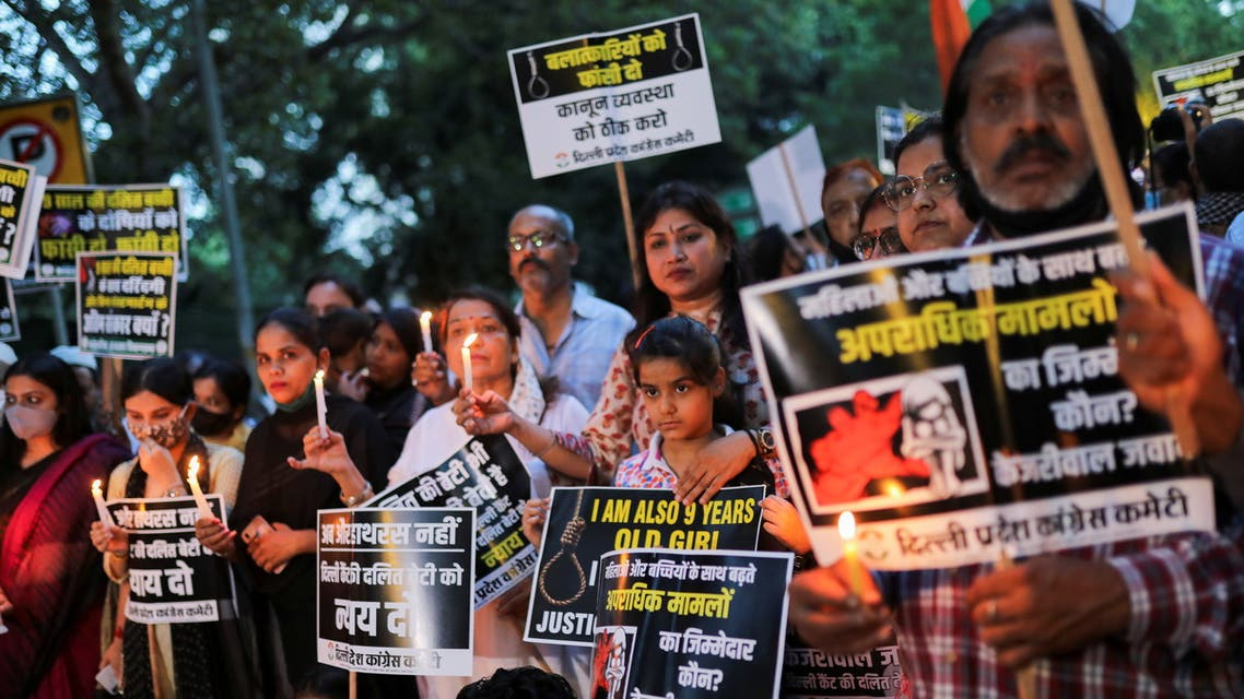 Supporters of India's main opposition Congress party attend a candlelight vigil to protest against the alleged rape and murder of a 9-year-old girl in New Delhi, India, August 4, 2021. (Reuters)