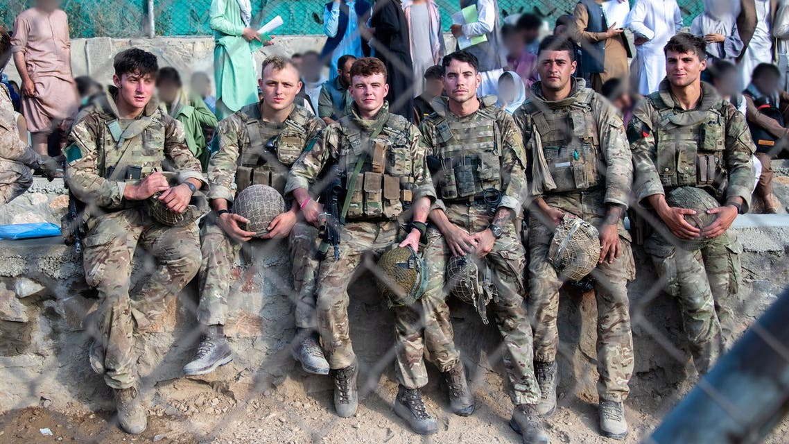 Members of the UK Armed Forces rest as they continue to take part in the evacuation of entitled personnel from Kabul airport, in Kabul, Afghanistan August 19-22, 2021, in this handout picture obtained by Reuters on August 23, 2021. LPhot Ben Shread/UK MOD Crown copyright 2021/Handout via REUTERS THIS IMAGE HAS BEEN SUPPLIED BY A THIRD PARTY. MANDATORY CREDIT. NO RESALES. NO ARCHIVES.