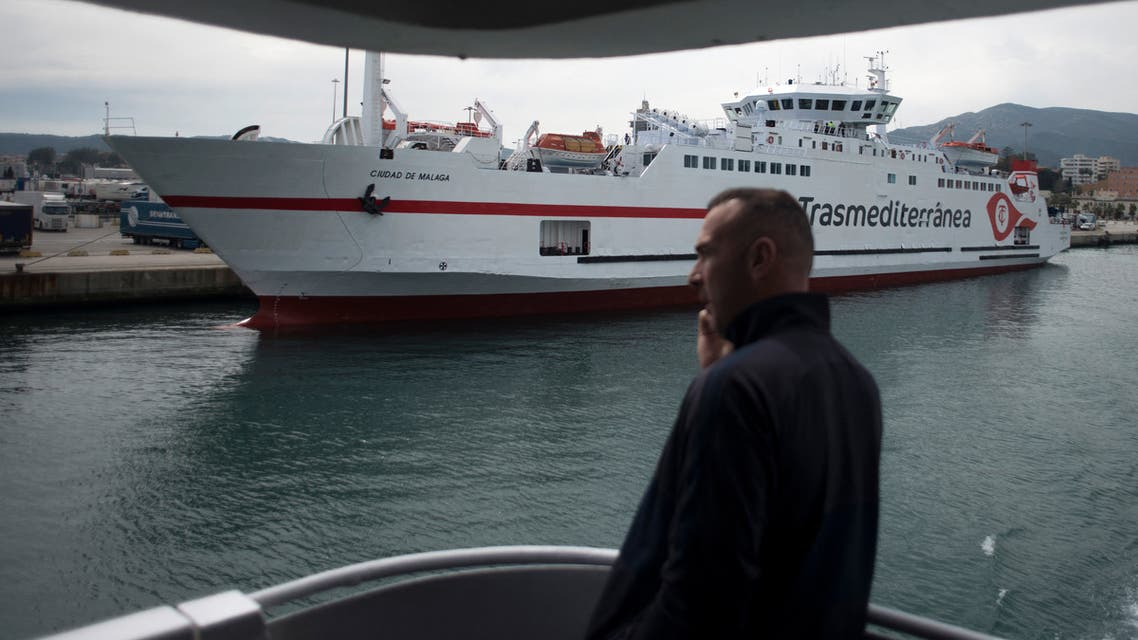 A man talks on a mobile phone aboard a ferry in Spain on March 13, 2020. (AFP)