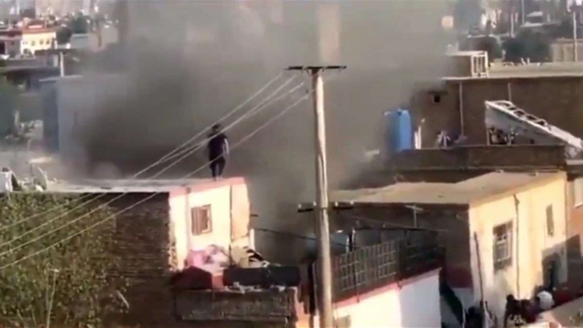Smoke rises from a house in Kabul after child was killed in a rocket attack northwest of Kabul airport, according to an Afghan police chief. (Twitter)