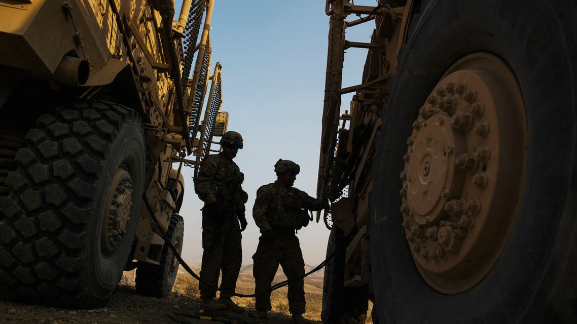 U.S. soldiers from the 3rd Cavalry Regiment use a cable to power a dead Mine Resistant Ambush Protected (MRAP) vehicle, during a training mission near forward operating base Gamberi, in the Laghman province of Afghanistan. (File photo: Reuters)