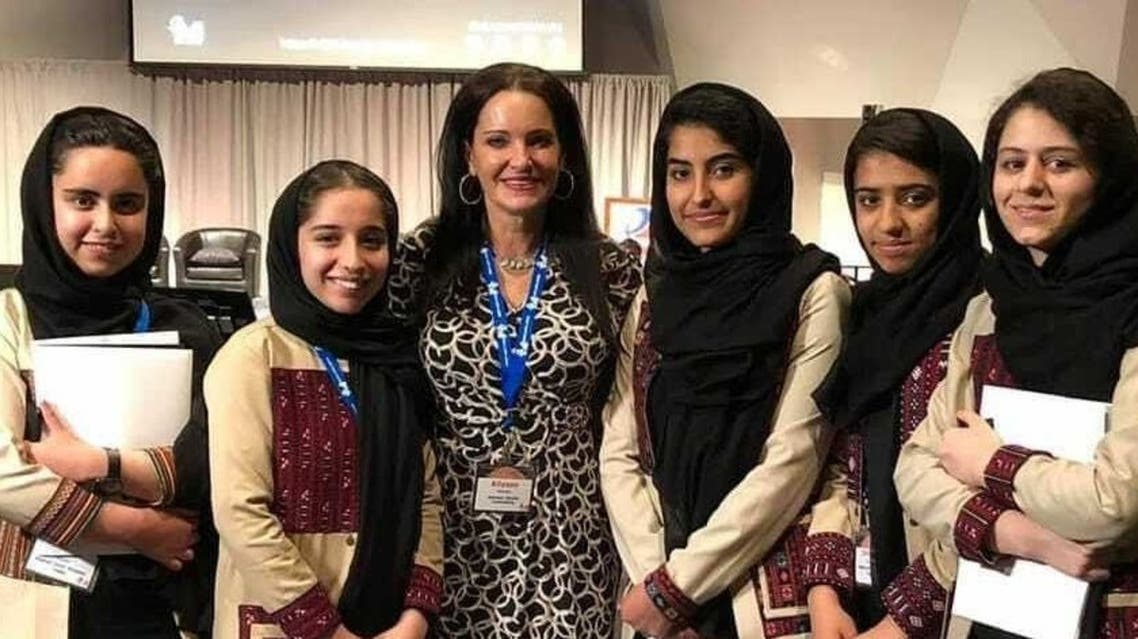 Allyson Reneau (center) is pictured with members of the Afghan girls robotics teams. (Twitter)
