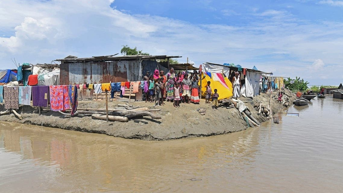 Villagers take shelter on higher grounds in a flood affected area of Morigaon district in India's Assam state on August 30, 2021. (AFP)