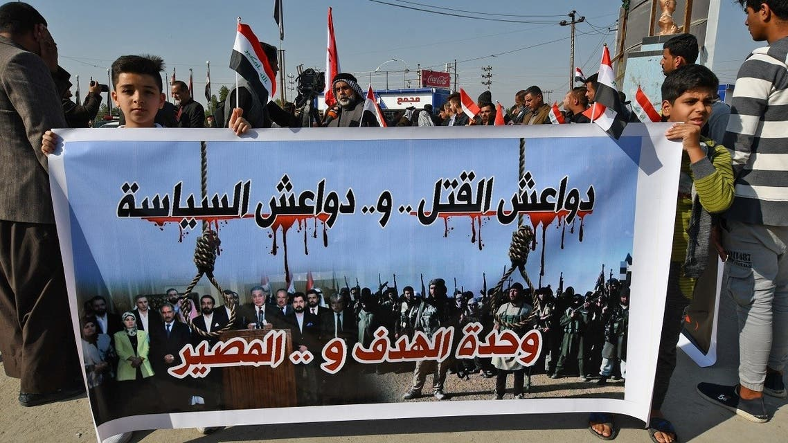 Iraqi residents and families of victims protest to demand the execution of Iraqis convicted of terrorism in Nasiriyah Central Prison, also known as al-Hout prison, in the southern Iraqi city of Nasiriyah in the Dhi Qar province on January 26, 2021. (AFP)