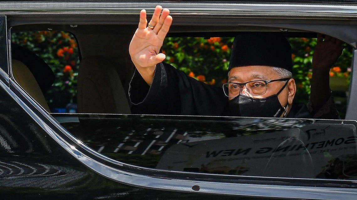 Malaysia's incoming PM Ismail Sabri Yaakob waving as he leaves his house on the way to taking the oath of office to become the country's new leader in Kuala Lumpur, August 21, 2021. (Famer Roheni/Malaysia's Department of Information/AFP)
