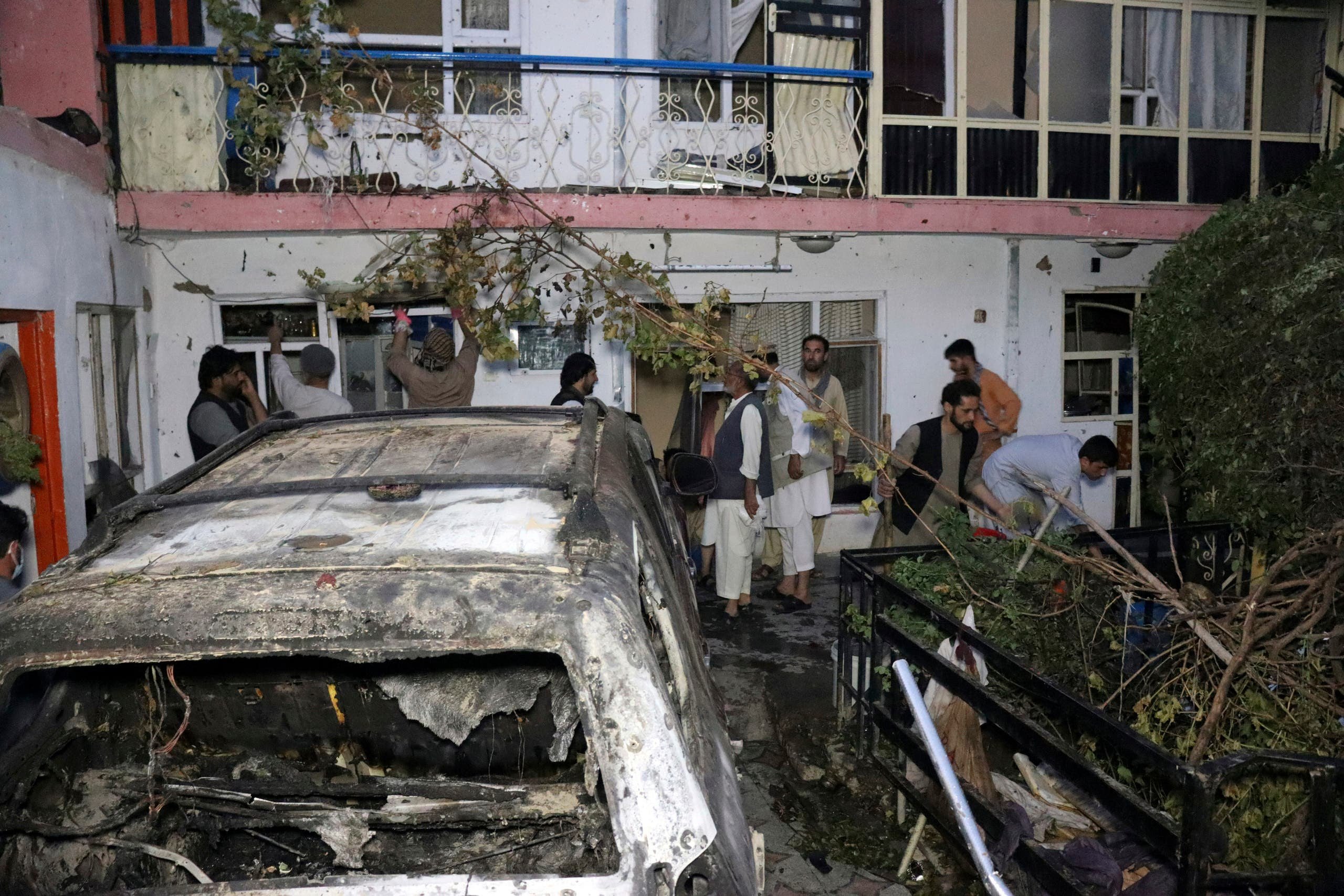 Afghan people are seen inside a house after US drone strike in Kabul, Afghanistan, Sunday, Aug. 29, 2021. (AP)