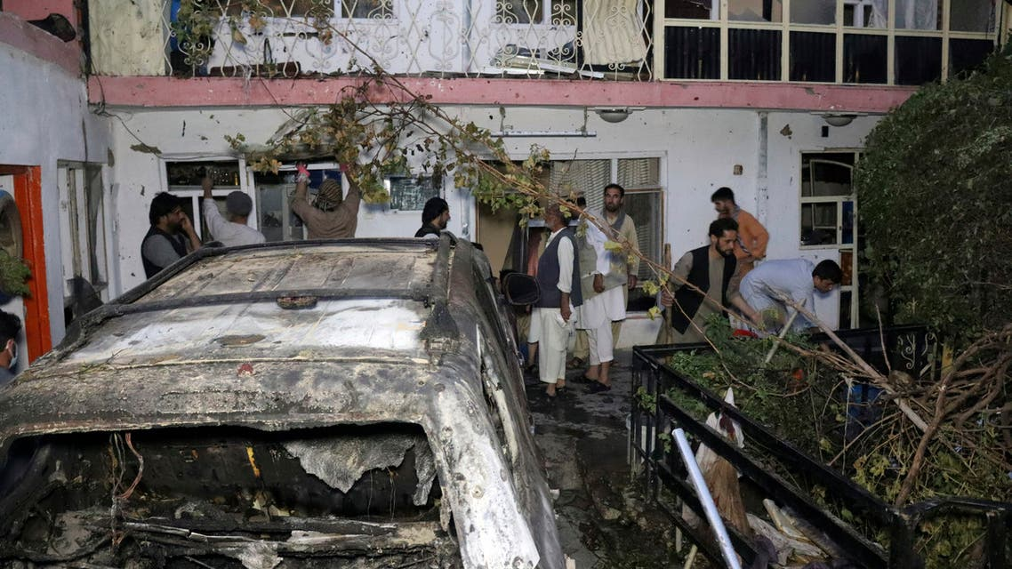 Afghan people are seen inside a house after US drone strike in Kabul, Afghanistan, Aug. 29, 2021. (AP)