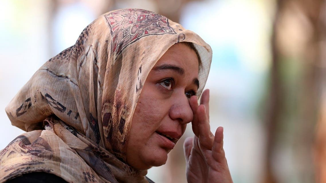Ghazaal Habibyar, one of the 457 Afghan evacuees housed in Albania, wipes her eye as she speaks during an interview with The Associated Press, Sunday, Aug. 29, 2021. (AP)