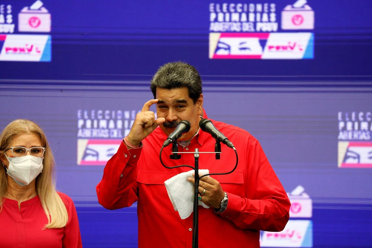 Venezuelan President Nicolas Maduro speaks to the media after voting in the ruling Socialist Party primaries for the November regional elections for governors and mayors, in Caracas, Venezuela August 8, 2021. (Reuters/Leonardo Fernandez Viloria)