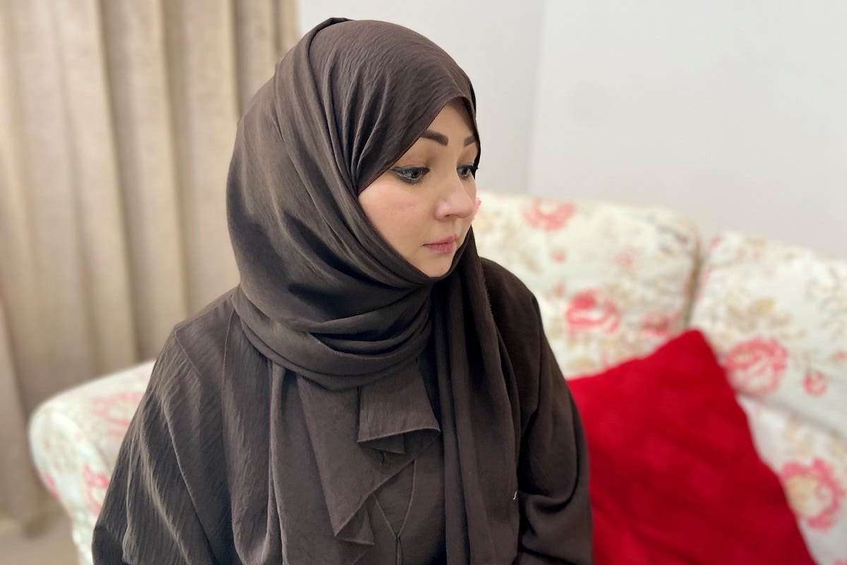 Abadat, 35, a woman from Afghanistan, is pictured at her home in Ajman, United Arab Emirates, August 29, 2021. (Reuters)