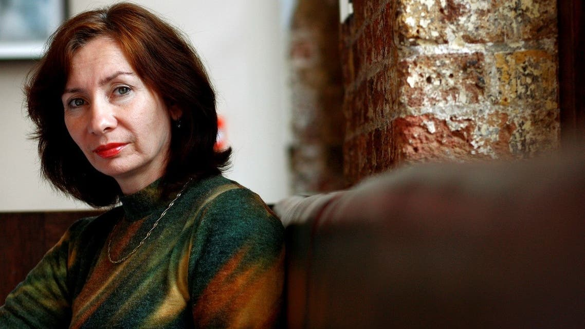Chechen journalist and activist Natalia Estemirova poses at the Front Line Club in London October 4, 2007. (Reuters/Dylan Martinez)