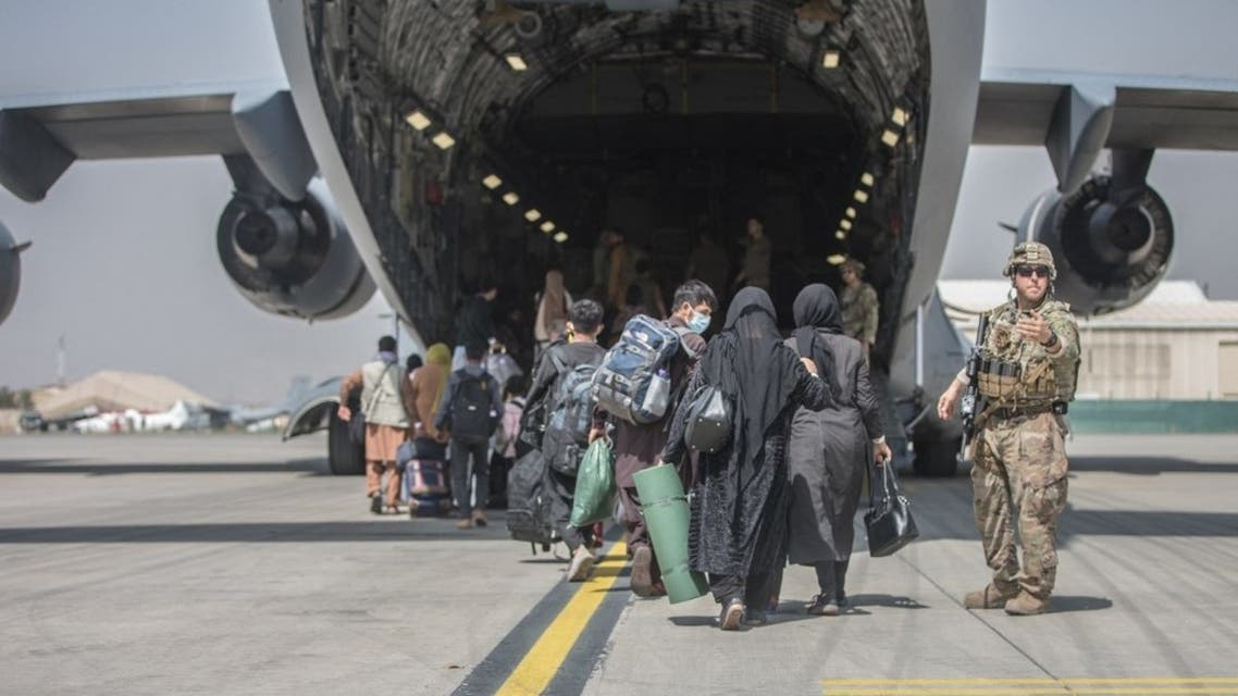 Families begin to board a US Air Force Boeing C-17 Globemaster III during an evacuation at Hamid Karzai International Airport, Kabul, Afghanistan, August 23, 2021. (AFP)