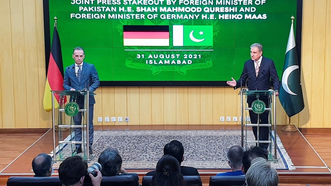 Pakistan's Foreign Minister Shah Mahmood Qureshi (R) along with his German counterpart, Heiko Maas addresses a news conference in Islamabad, Pakistan, on August 31, 2021. (Reuters)