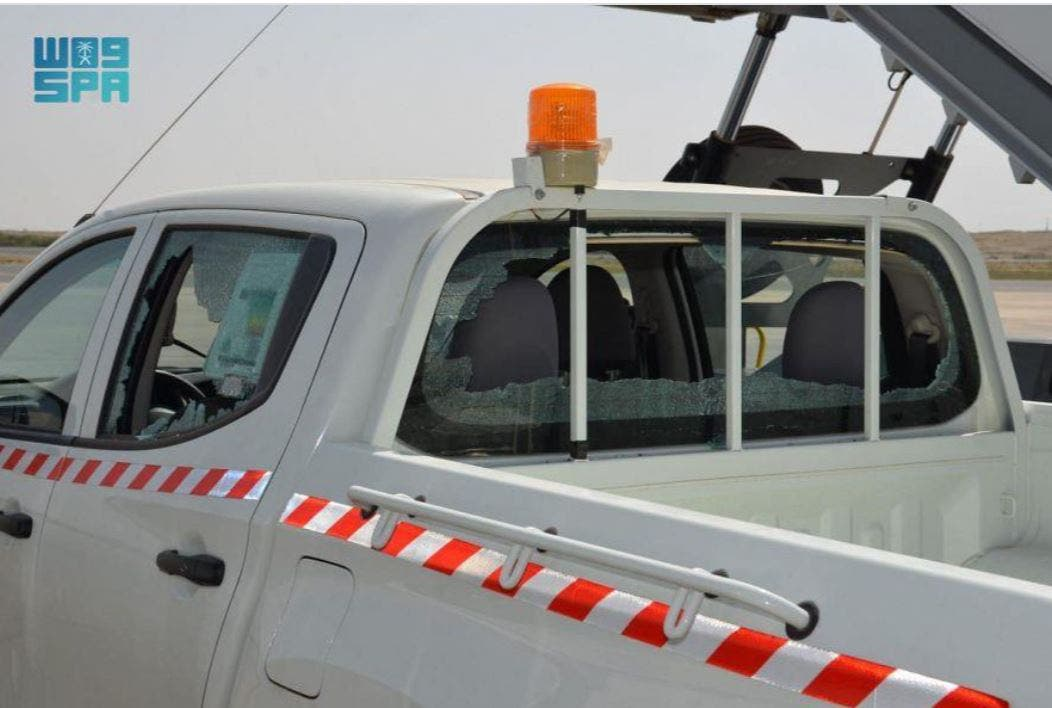 A truck that belongs to airport staff members was damaged after a Houthi drone was destroyed. (SPA)