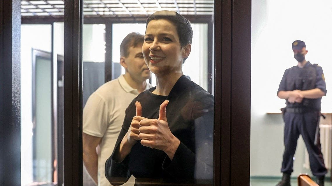 Maria Kolesnikova gestures inside the defendants' cage at the opening of her trial on charges of undermining national security, conspiring to seize power and creating an extremist group, in Minsk on August 4, 2021. (Ramil Nasibulin/BELTA/AFP)