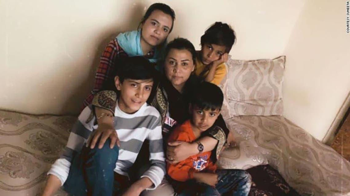 Suneeta hugs her children in this image taken earlier this year. (Photo courtesy: CNN)