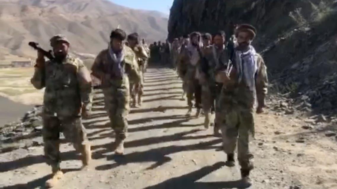Anti-Taliban resistance troops walk in Panjshir Valley, Afghanistan August 25, 2021 in this still image taken from video. (Reuters)