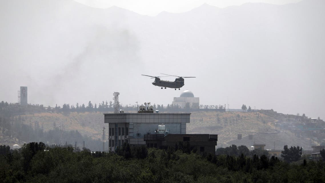 In this Sunday, Aug. 15, 2021 file photo, a US Chinook helicopter flies over the US embassy in Kabul, Afghanistan. (AP)