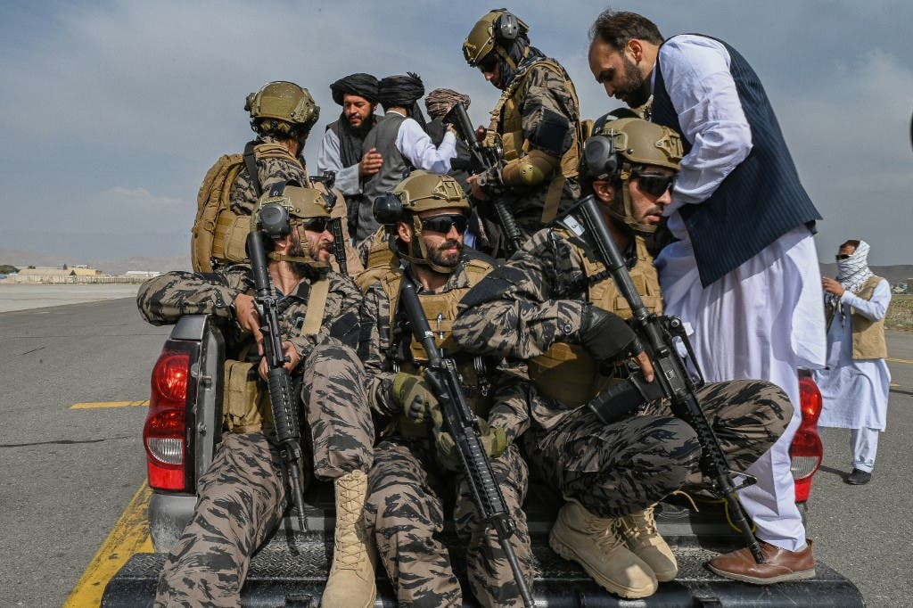 Taliban Badri special force fighters climb up on a vehcile at the airport in Kabul on August 31, 2021. (AFP)