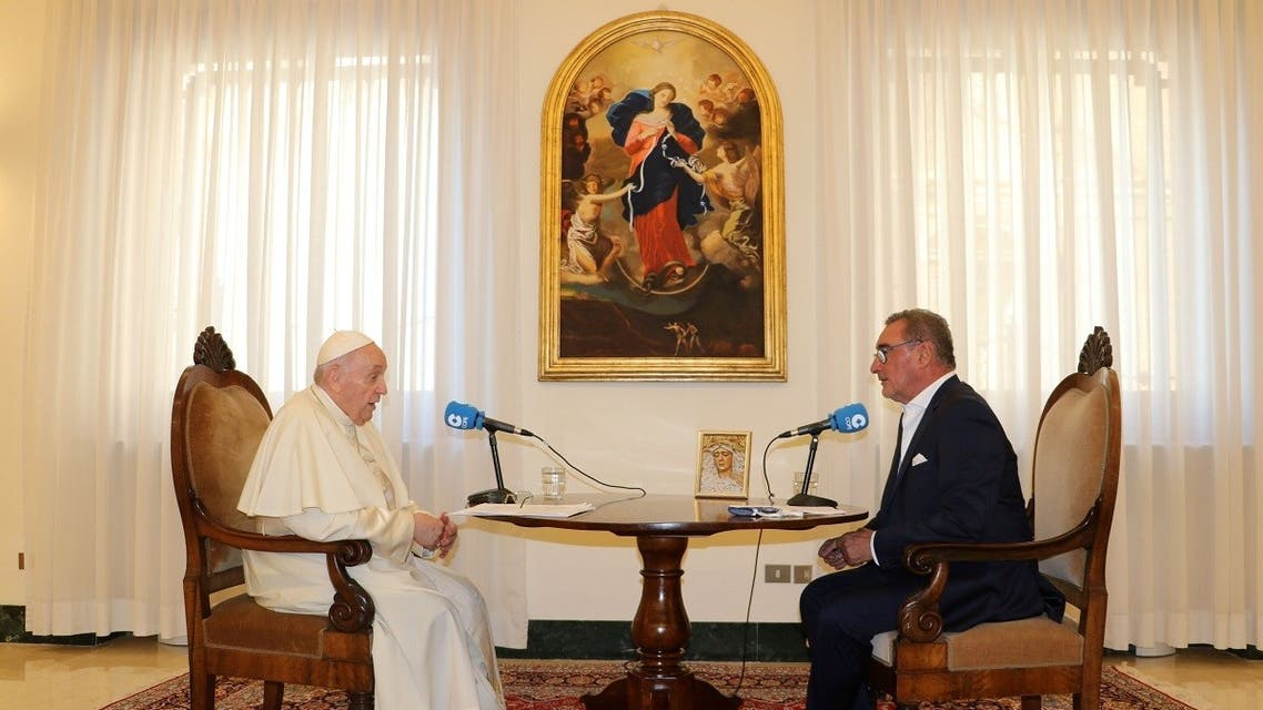 Pope Francis and journalist Carlos Herrera talk during an interview with Spanish radio station COPE at the Vatican City in this picture released on September 1, 2021. (Reuters)