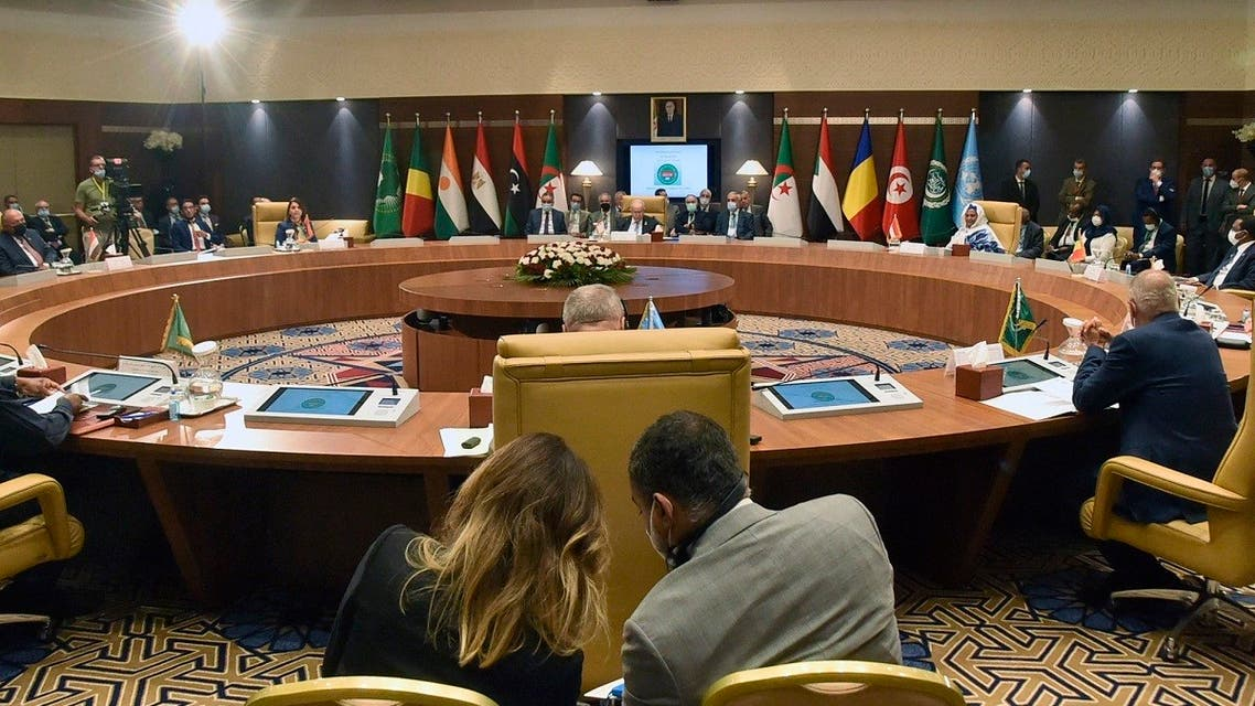Officials attend a meeting by Libya's neighbors as part of international efforts to reach a political settlement to the country's conflict, in the Algerian capital Algiers, on August 30, 2021. (Ryad Kramdi/AFP)