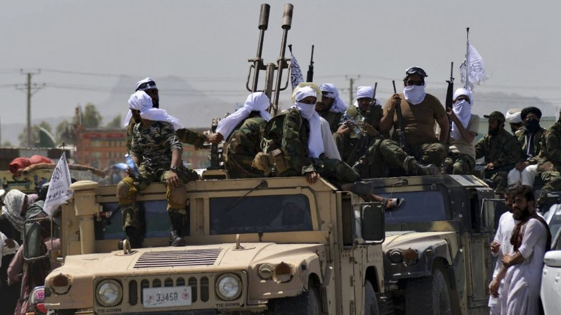 Taliban fighters atop Humvee vehicles parade along a road to celebrate after the US pulled all its troops out of Afghanistan, in Kandahar on September 1, 2021 following the Taliban's military takeover of the country. (AFP)
