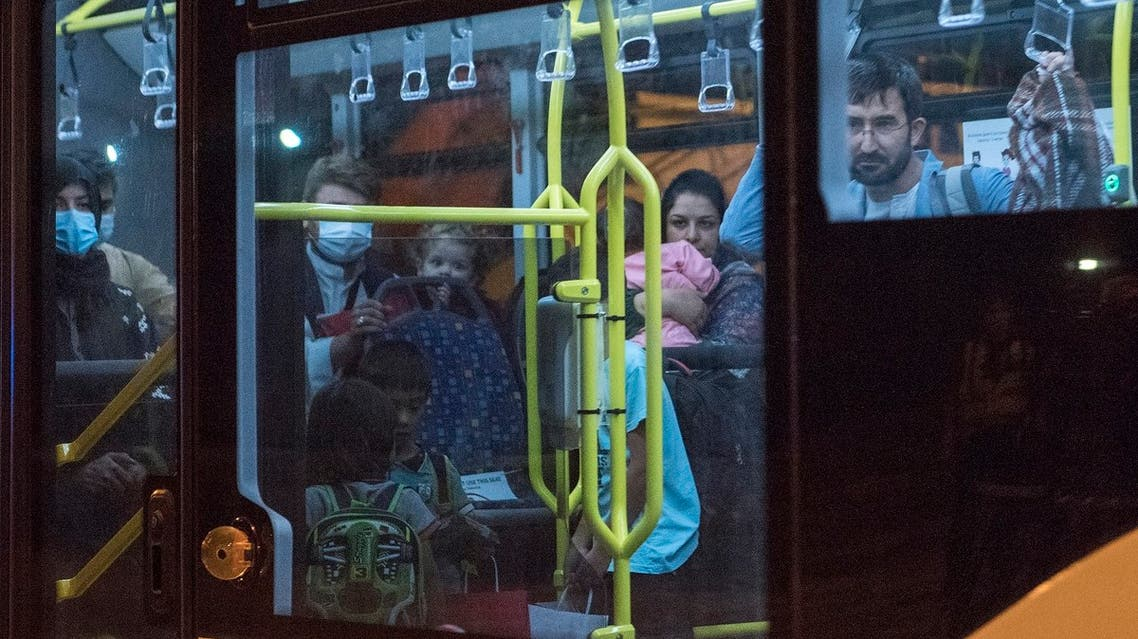 Afghan refugees are seen onboard a bus upon arrival at Skopje International Airport, in Skopje on August 30, 2021, after being evacuated from Kabul following the Taliban takeover of Afghanistan. A first group of 149 Afghan evacuees landed late August 30, 2021 in North Macedonia, where they will stay for a few months pending resettlement elsewhere.