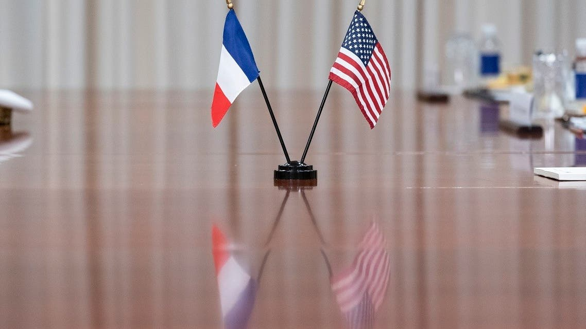 Flags are seen on the table during a meeting with Secretary of Defense Lloyd Austin and French Minister of the Armed Forces Florence Parly at the Pentagon, July 9, 2021. (AP)