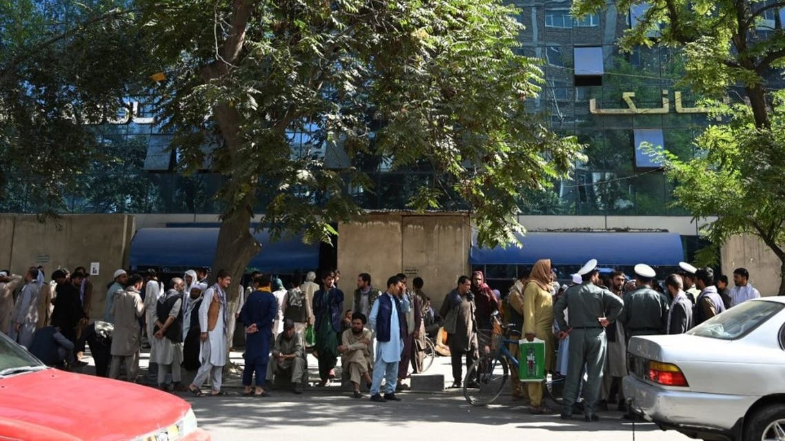 Bank account holders gather outside a closed bank building in Kabul on August 28, 2021, following the Taliban's stunning military takeover of Afghanistan. (AFP)